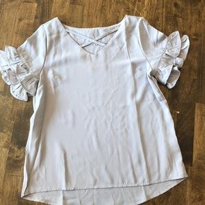 Gray blouse with crisscross neckline